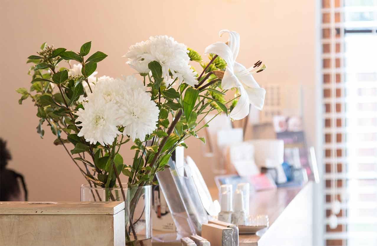 White flowers on Gingerlily reception desk